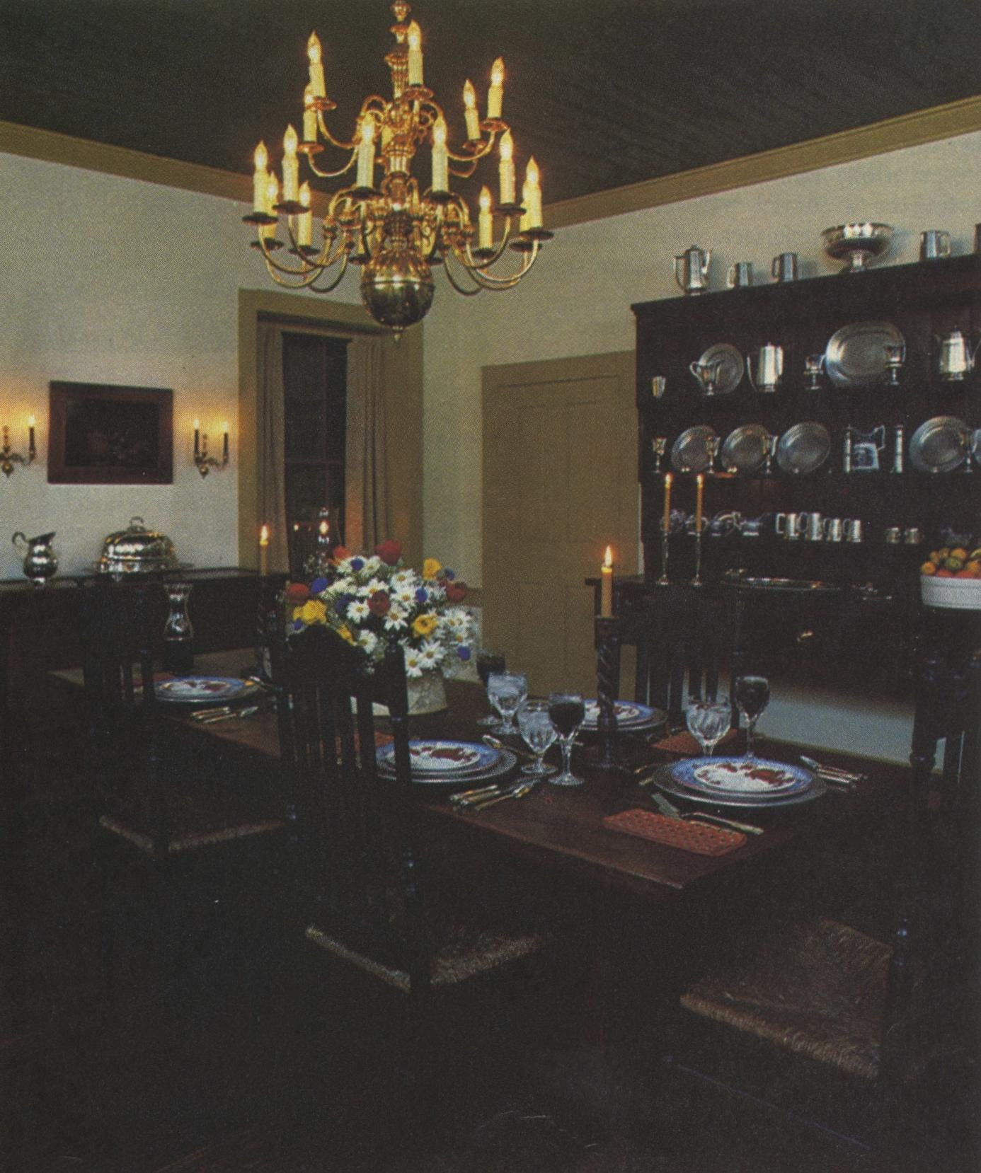 The formal dining room houses a wealth of collectibles, like an early-nineteenth-century brass chandelier from Philadelphia and a late-eighteenth-century Welsh dresser.