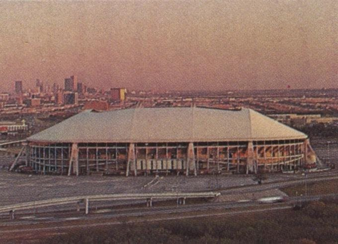 Texas Stadium against the Dallas skyline.