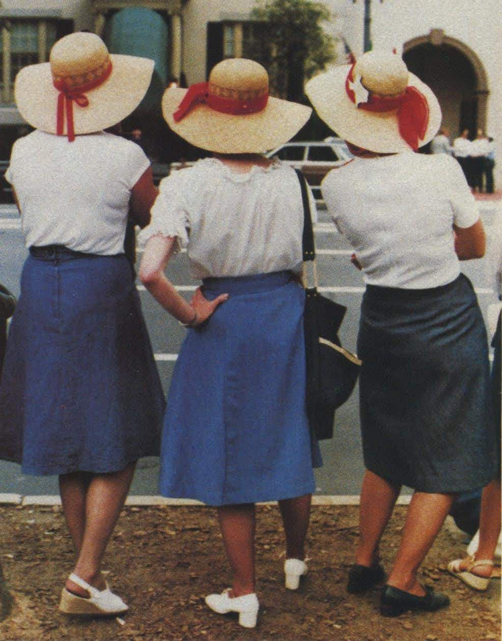 "María H. Sandoval, San Antonio ""The appeal is in the lines of the foreground subjects, the way each woman has her hips and feet in a different position, and the shapes of the hats. The color quality is excellent, too."""