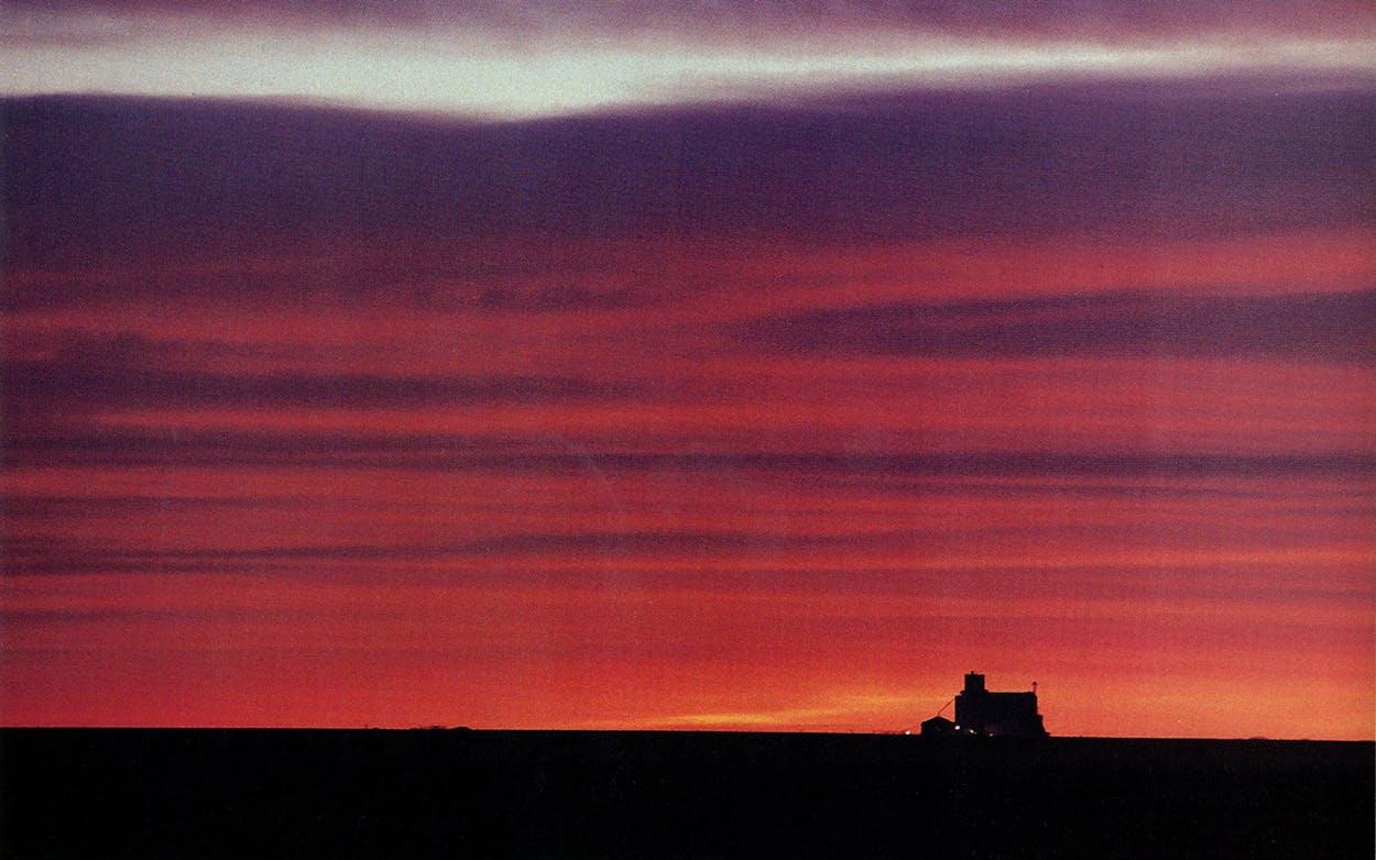 A grain elevator rises from the fertile plain near Channing.