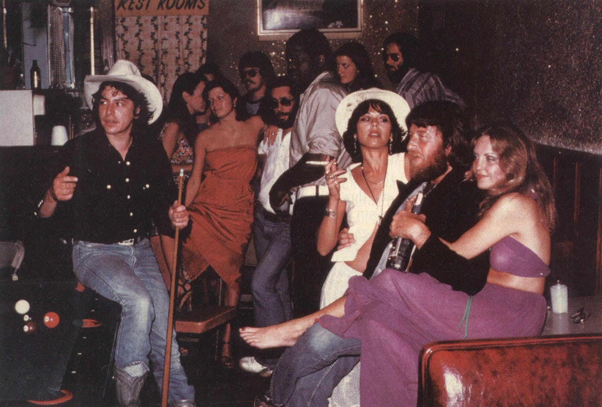 Mid-seventies: The Joe Ely Band hanging out with C. B. Stubblefield (center) at Stubb's Bar-B-Q. From left, Ely, steel guitarist Lloyd Maines (against the back wall), accordion player Ponty Bone, bassist Greg Wright (in the corner), guitarist Jesse Taylor.