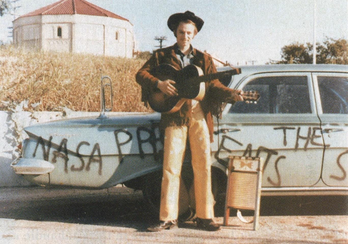 Mid-sixties: Norman Odam, the Legendary Stardust Cowboy, in front of his car.