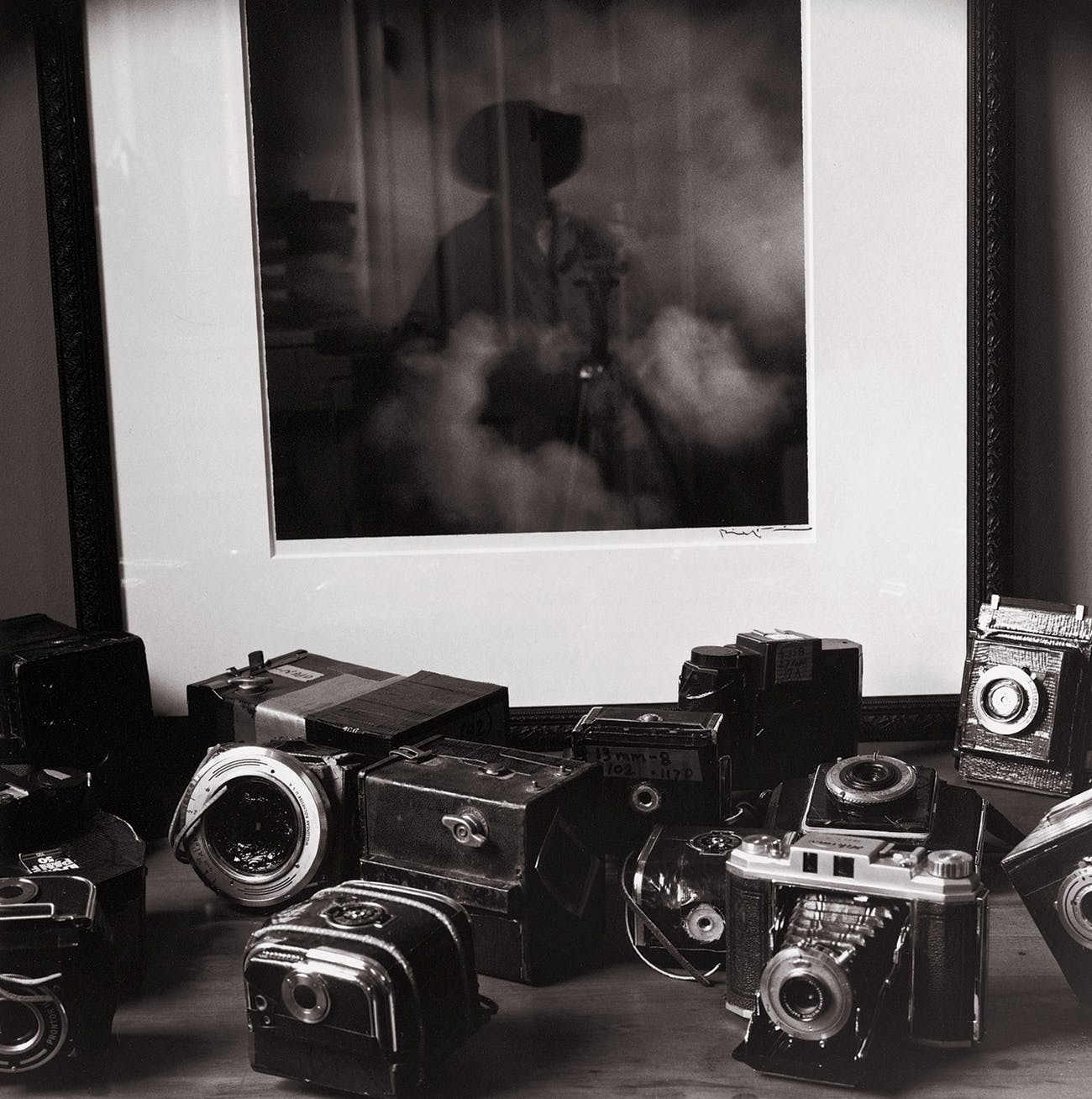 "Wittliff rebuilt these cameras, replacing each lens with a pinhole punched in a piece of cheap pie pan; he calls the cameras tragaluces (""light swallowers""). Behind them is a tragaluz picture he took in Mexico titled Nubes (""Clouds""). ""I was trying to find a way to see through my own eyes, and I'm kind of a retro guy, so I went back to one of the earliest forms of photography,"" he says. ""It's just amazing what you can make a camera without a lens do."""