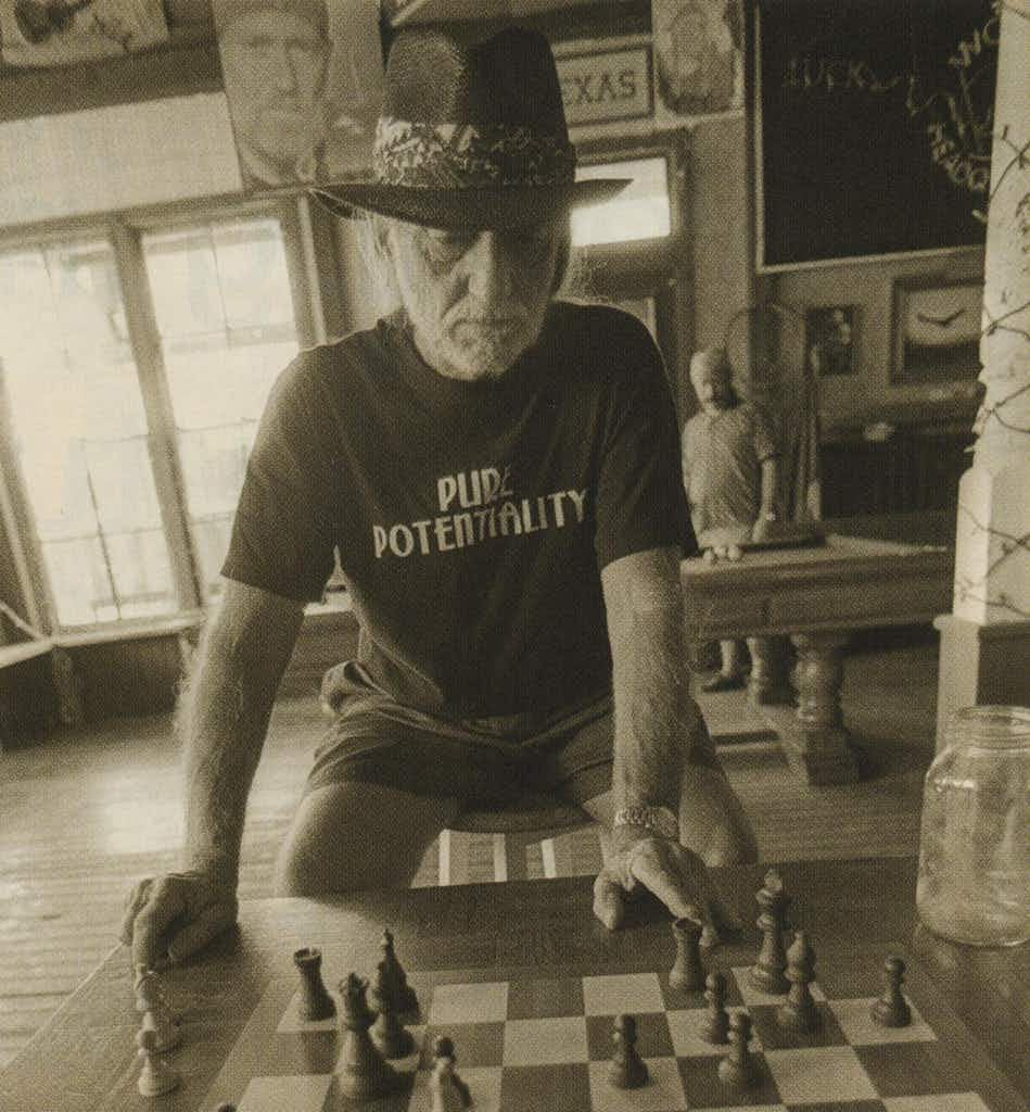Chairman of the Board: Playing chess at his compound in Luck.