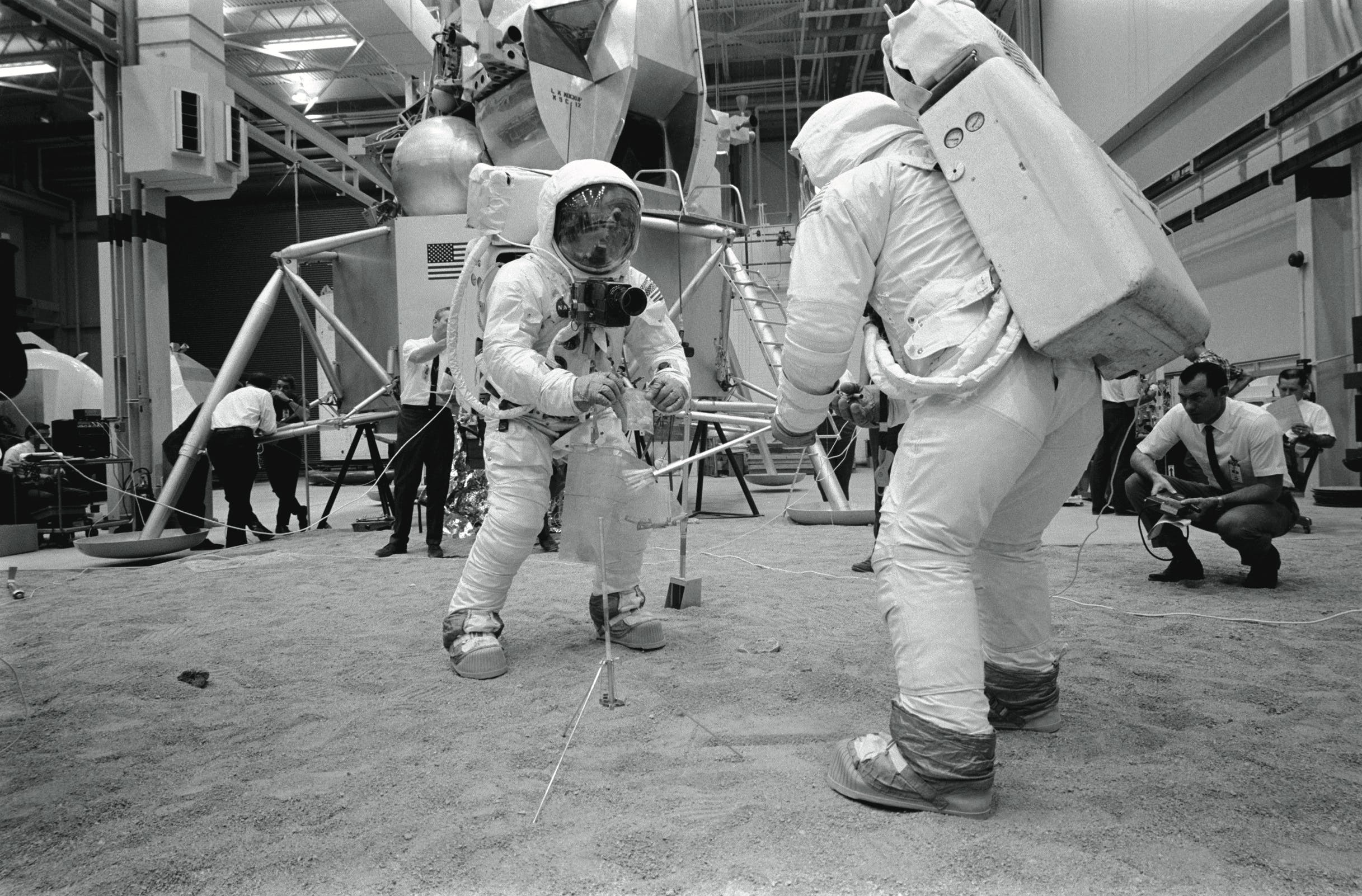 Armstrong and Aldrin practice taking lunar samples.