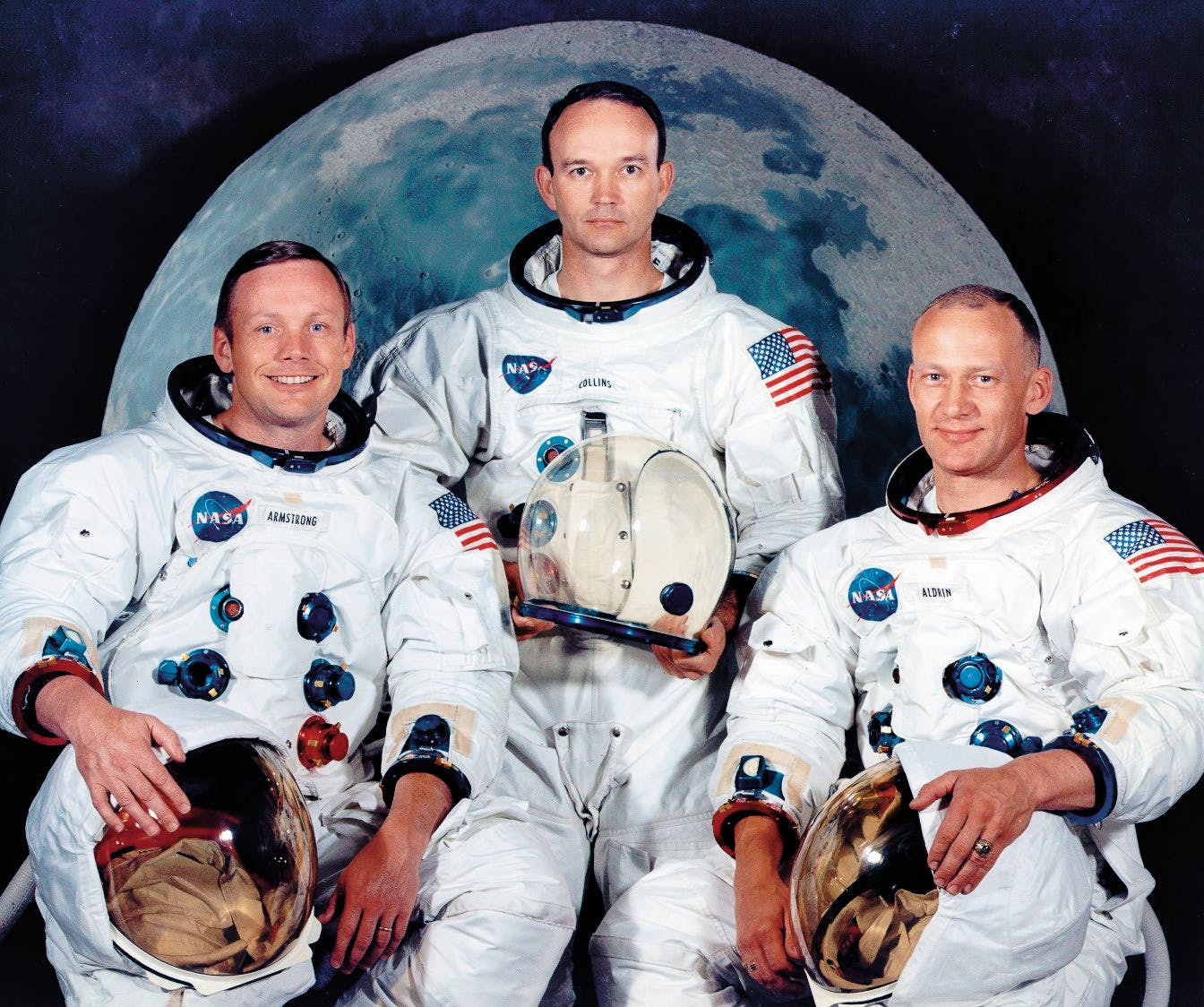 Armstrong, Michael Collins, and Aldrin pose for an official NASA portrait.