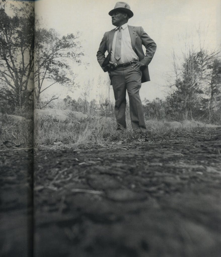 Lee Arthur Wilson stands where his cousin was left by the side of the road.