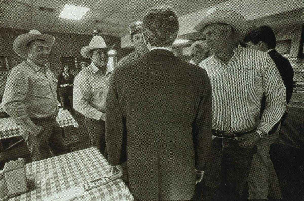 Like his father, Bush gets an adrenaline rush when he's out campaigning. Making his pitch to some farmers and ranchers at a barbecue joint in Uvalde.