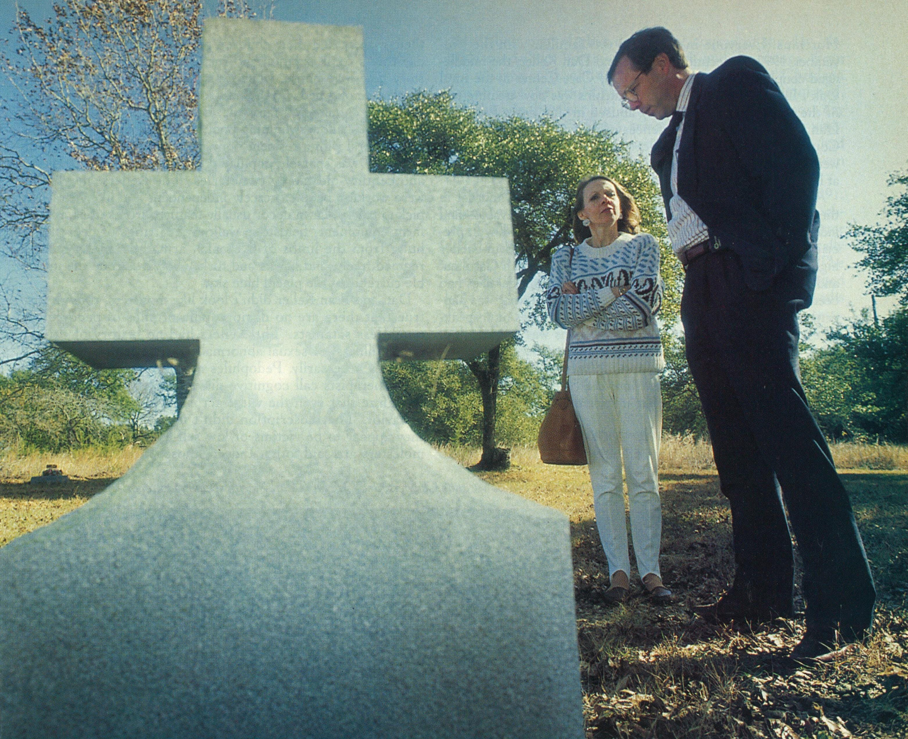 Sergeant Larry Oliver with Suzanne Chaviers inspecting graves at a cemetery near Austin where the Kellers allegedly buried their victims.