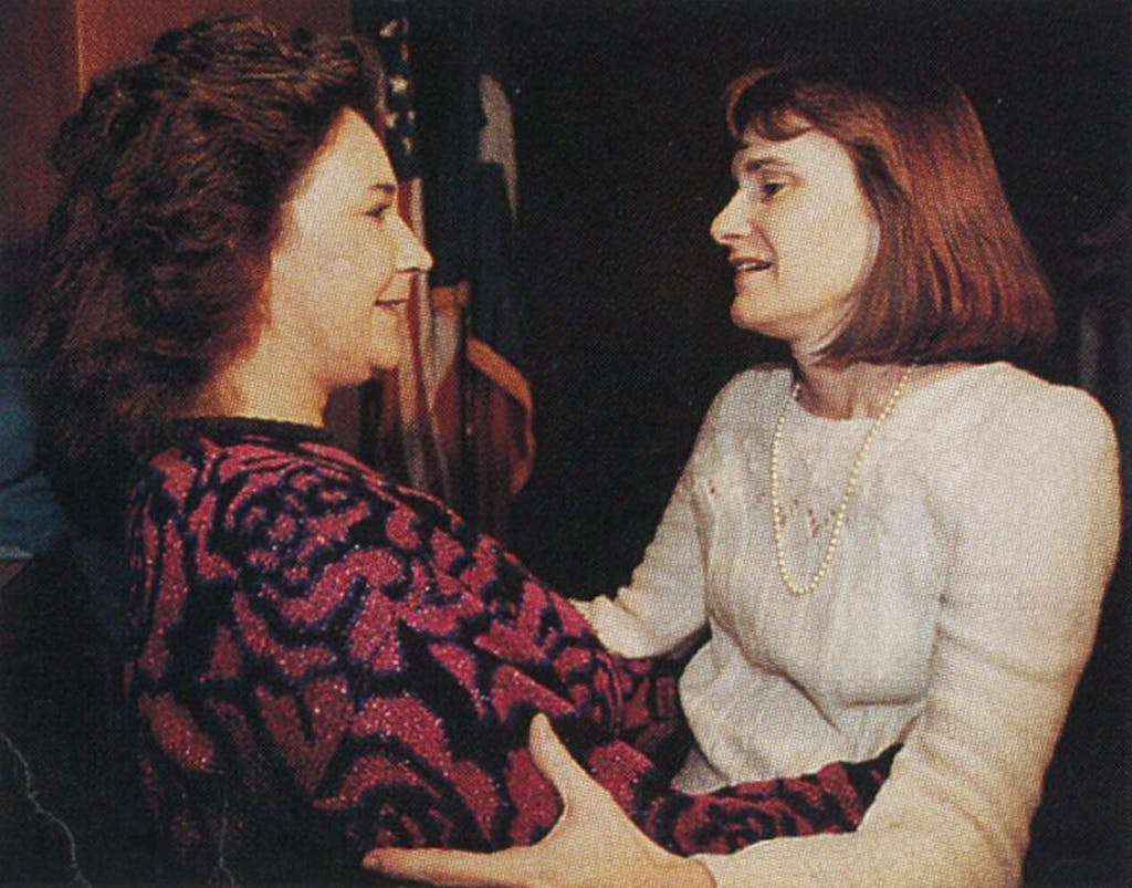 Sandra Nash (right) embracing an unidentified woman after the jury found the Kellers guilty.