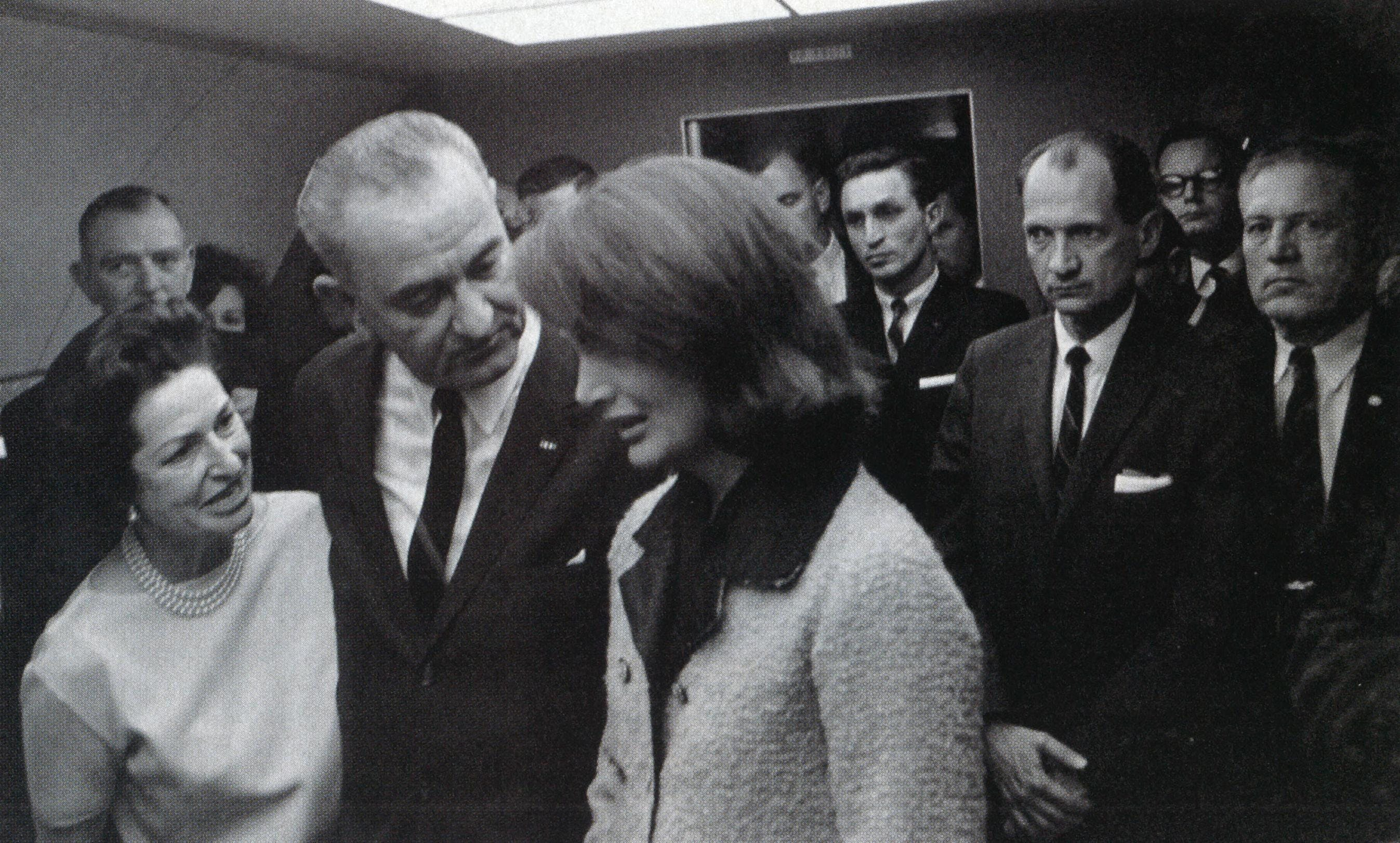 Shortly after the murder of President Kennedy, Lady Bird and LBJ comfort Mrs. Kennedy aboard Air Force One. Johnson later denied accusations that he had been insensitive to the Kennedy family after the tragedy.