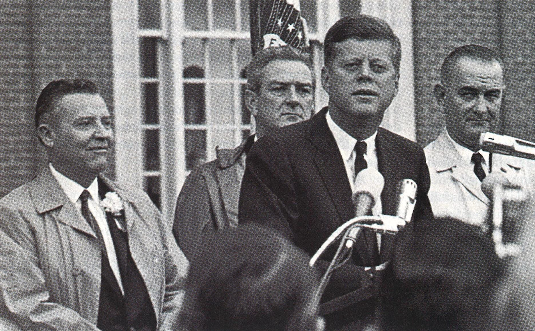 "Texas senator Ralph Yarbrough (far left, next to John Connally) listens a speech in Fort Worth during Kennedy's trip to Texas. The media reported that Yarborough refused to ride in the same car as Johnson in a motorcade, and LBJ commented that the ""newspaper boys went wild. It was the biggest [thing] ever since de Gaulle farted."""