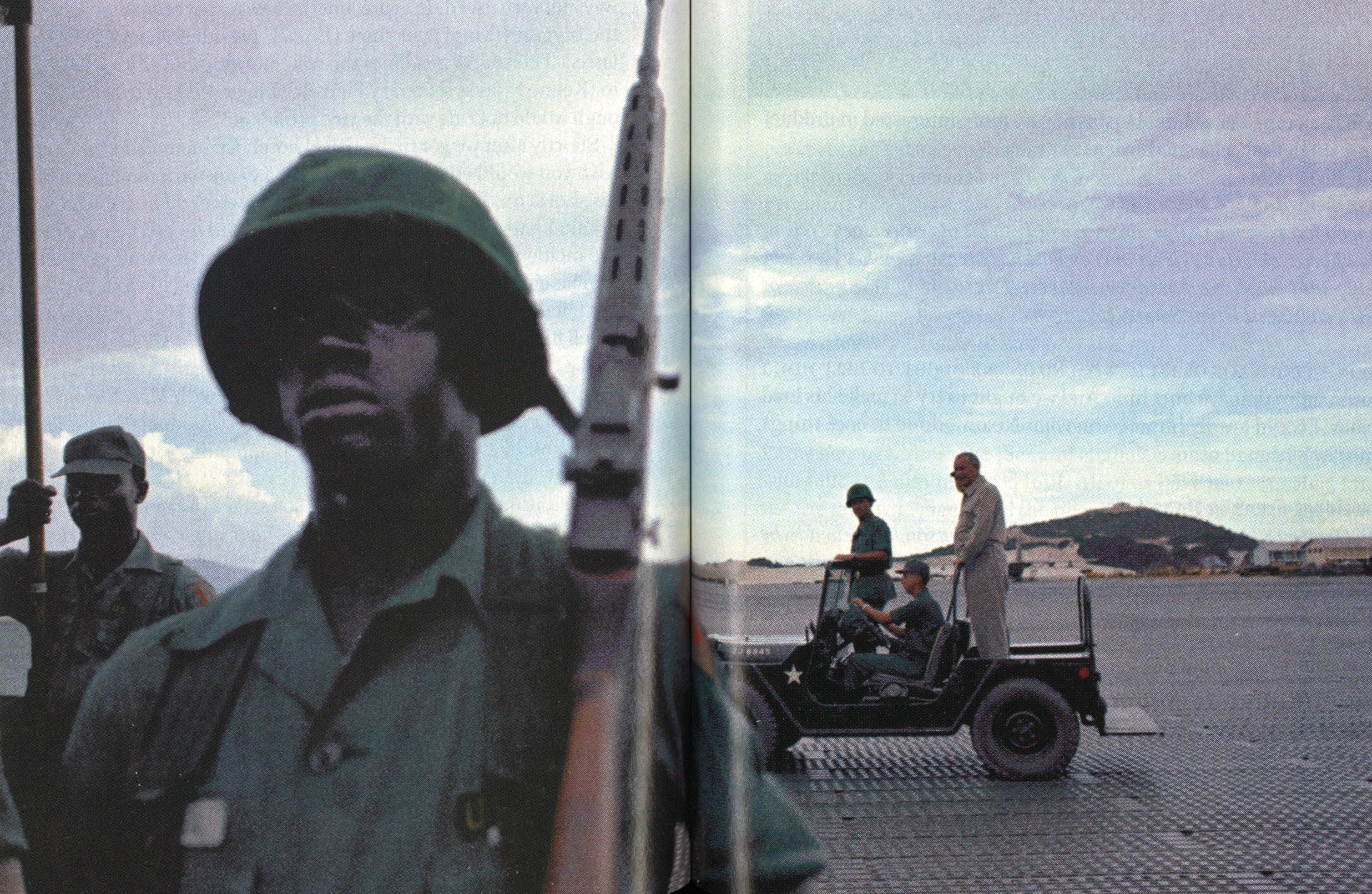 Johnson (standing in the Jeep) visits Cam Ranh Bay, South Vietnam, in October 1966 to help boost the morale of the troops.