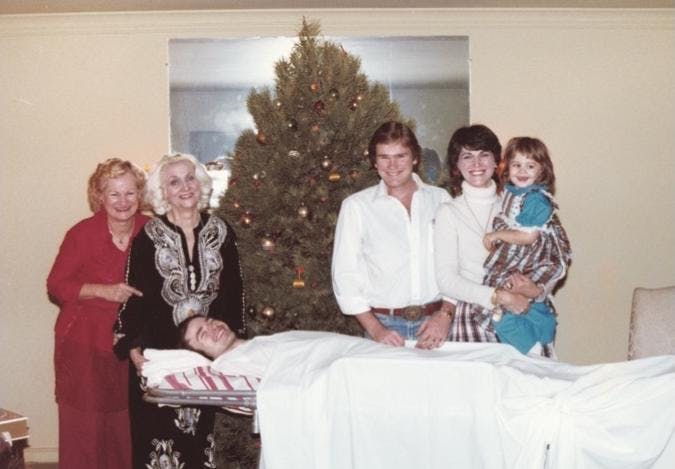 Christmas at the McClamrocks' housein the early eighties, with John and (from left) Ann; Ann's sister, Mary Ellen; Henry; Frances Ann Giron; and her daughter, Marita Ellen.