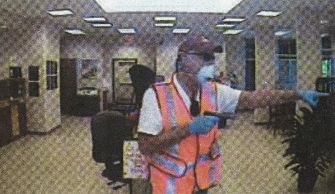A frame from a surveillance video of the Catts' second robbery, at First Community Credit Union, where they took $30,000.