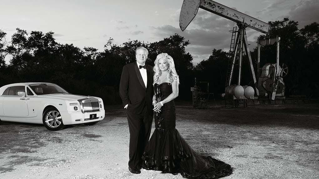 Theresa and Lamar with one of their rigs and Rolls-Royce in Alvin in August 2012.