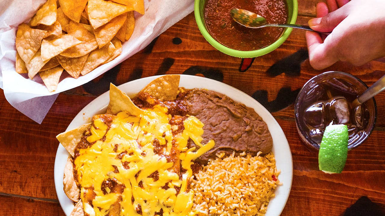 Dig into a plate of chili cheese enchiladas at Julia's Restaurant.