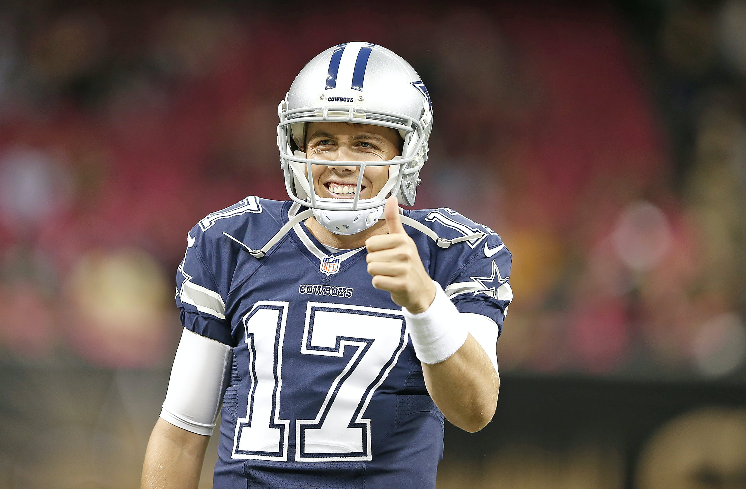 Dallas Cowboys quarterback Kellen Moore (17) gives a thumbs up before an NFL game against the New Orleans Saints at the Mercedes Benz Superdome in New Orleans, Louisiana, Sunday, October 4, 2015.   The Saints defeated the Cowboys in overtime, 26-20.  (James D. Smith via AP)