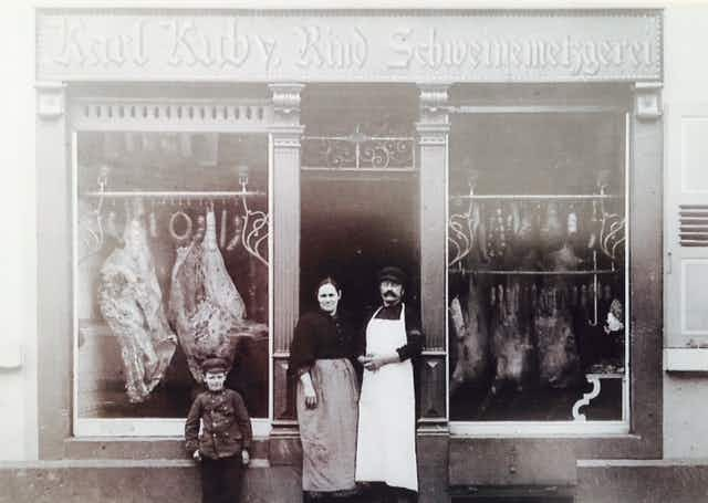 Karl Kuby Jr.'s great grandparents and grandfather (as a child) in front of their butcher shop in Germany circa 1904. Photo provided by Karl Kuby Jr.