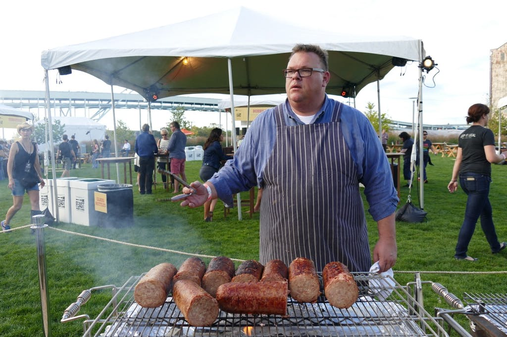 Chris Shepherd with his bacon sausage, at Feast Portland.