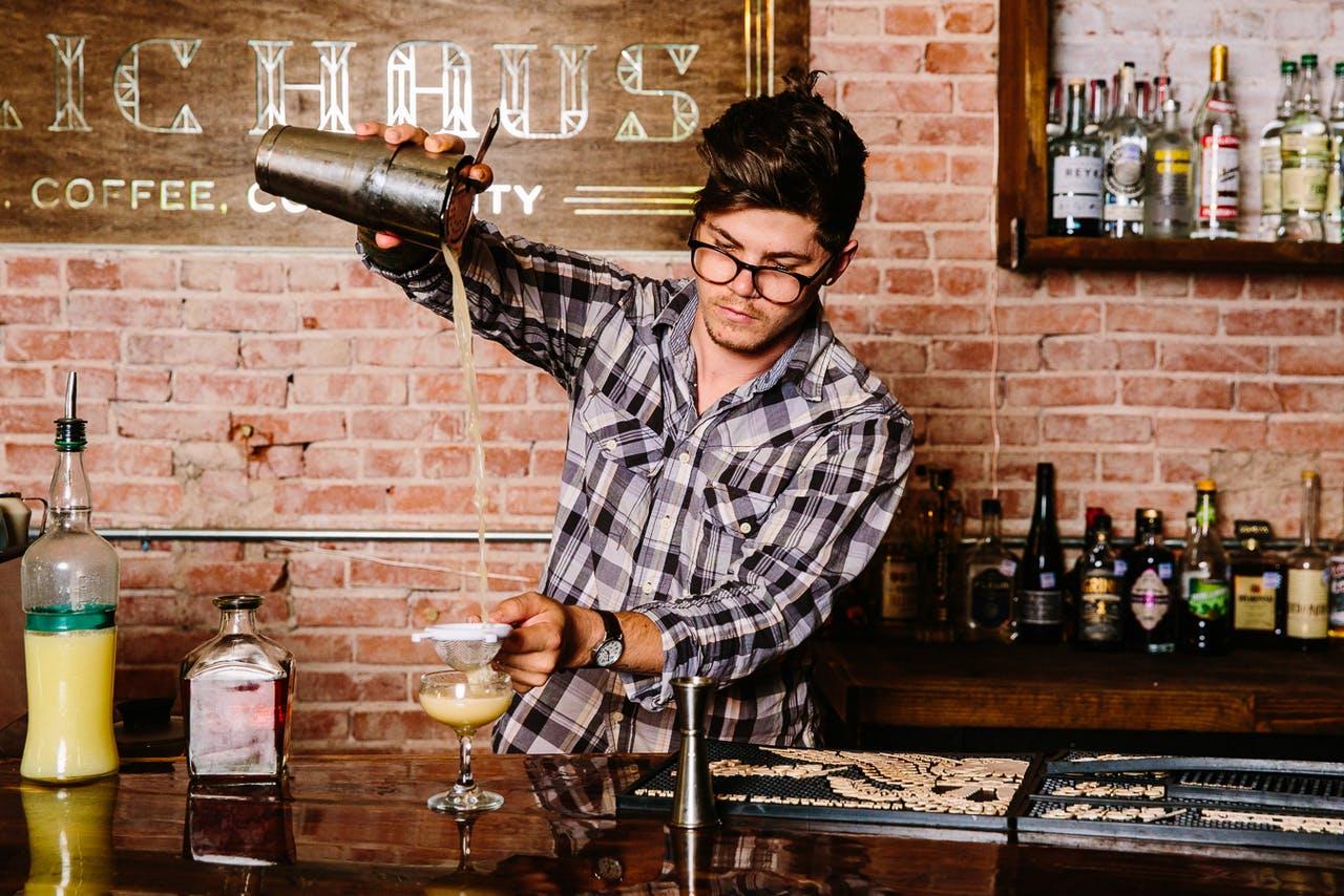 Bartender Logan Burkham pours a drink at Public-Haus.