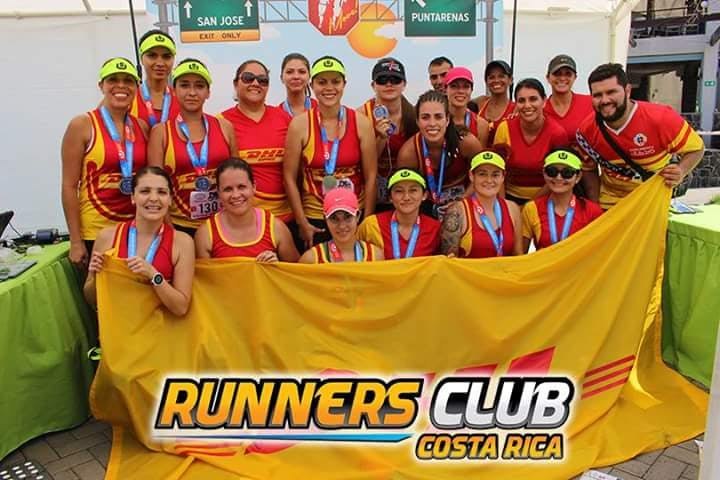Youssef Khater appears in the back row (behind the woman in a red ball cap) of this group photo of a Costa Rican Runners Club.