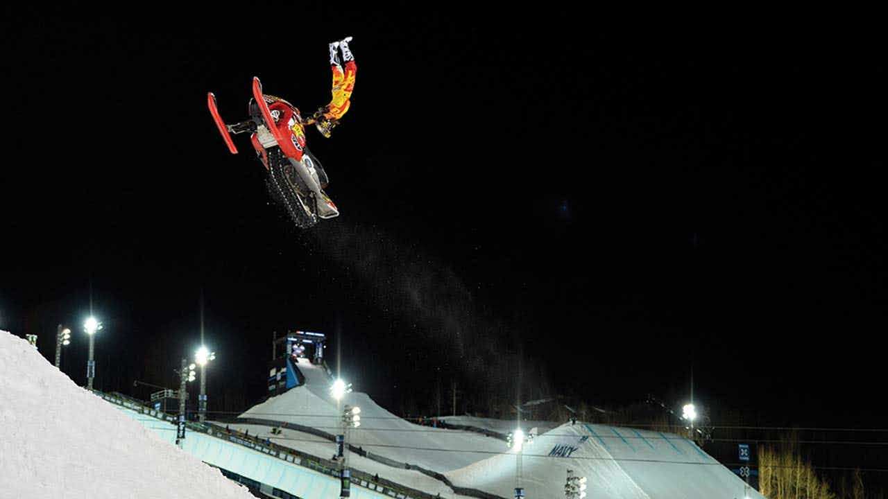 Colten participating in the Snowmobile Freestyle practice at the 2014 Winter X Games.