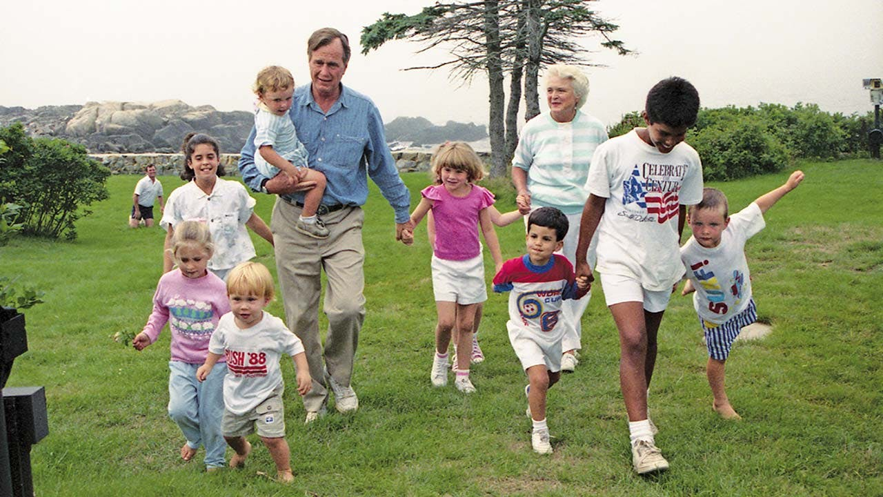 In 1988, walking (second from right) with his famous family, including soon-to-be president George H.W. Bush and his wife, Barbara.
