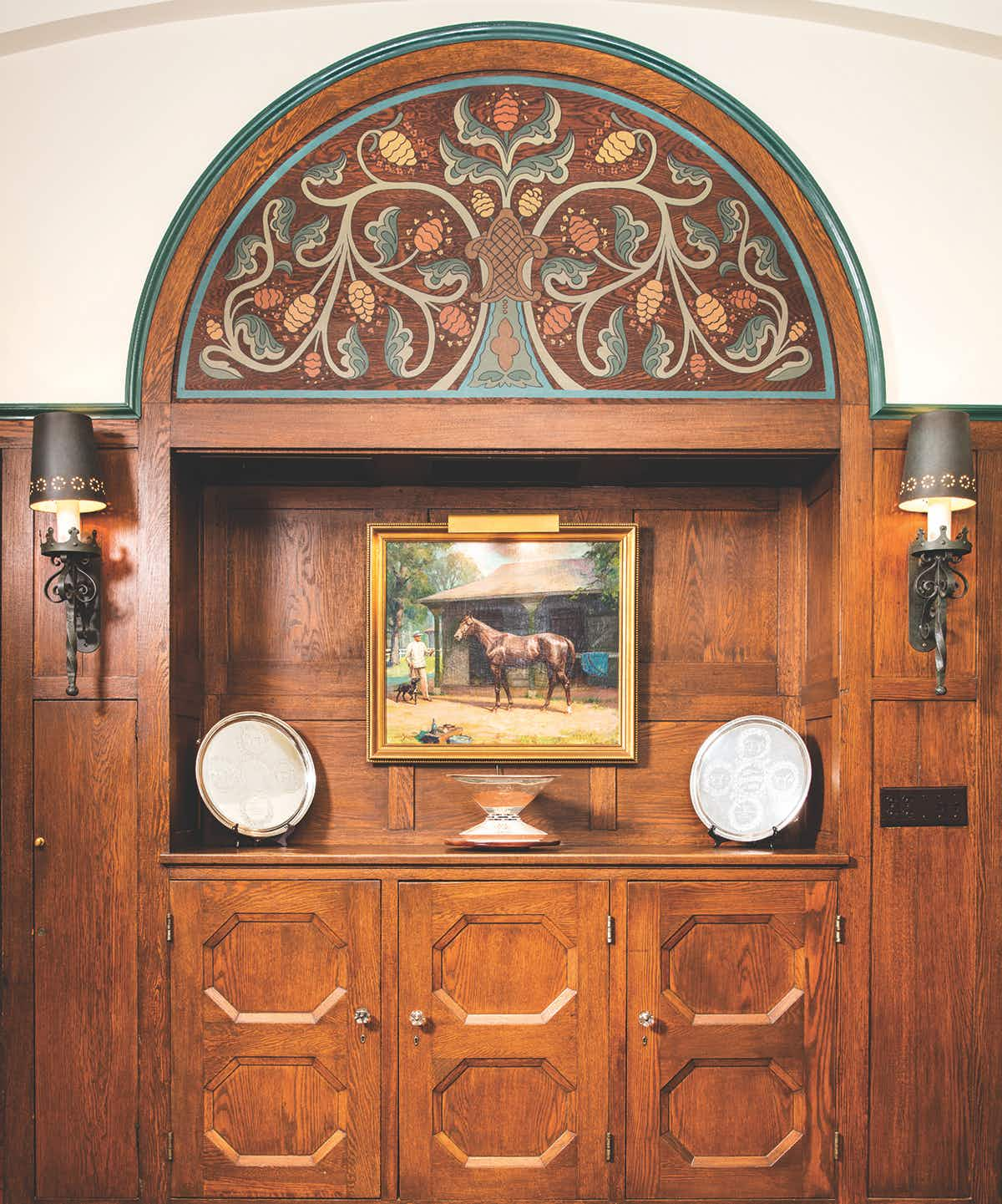A Tiffany-designed China cabinet in the dining room now serves as a display case for the Belmont Stakes trophies won by King Ranch Thoroughbreds and for the Triple Crown trophy won by Assault.