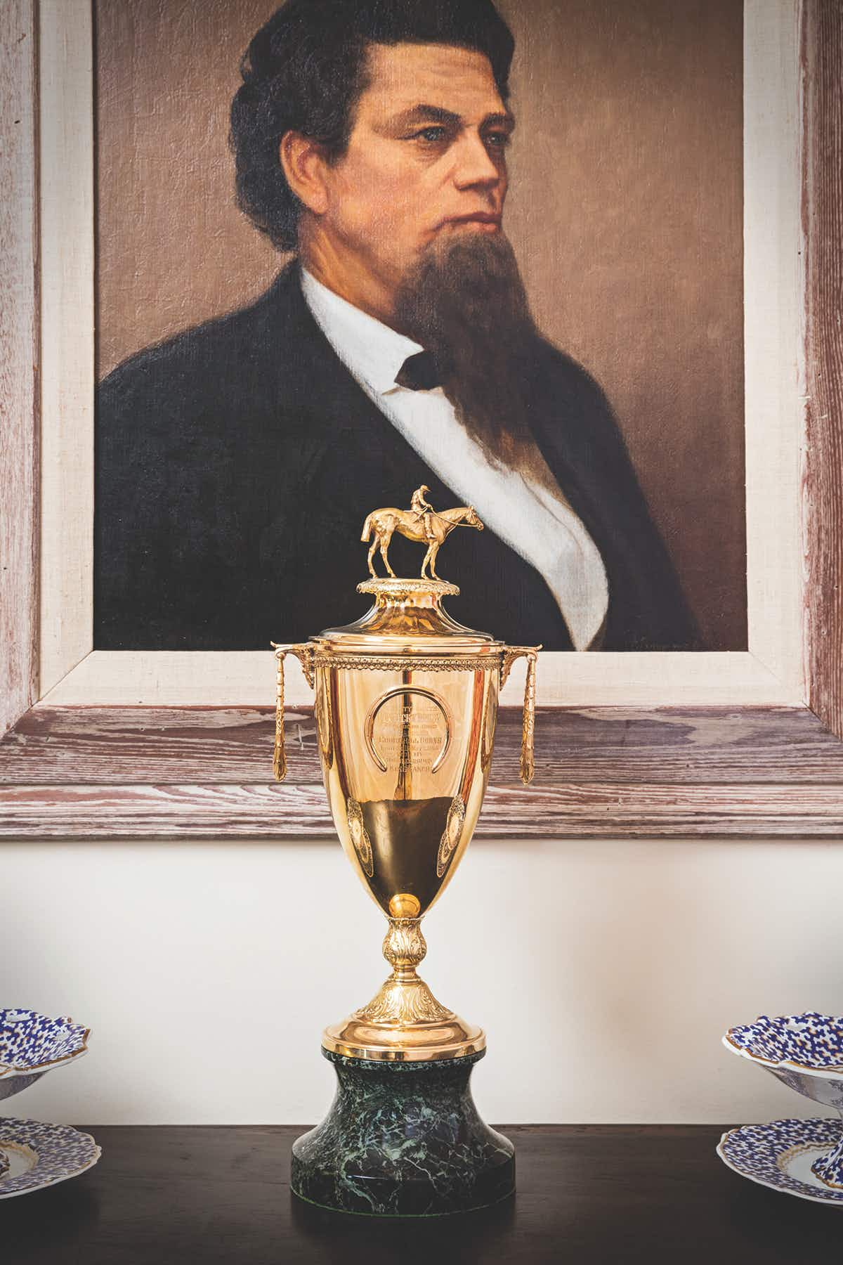 A painting of Captain Richard King hangs above a Kentucky Derby trophy won by one of the family's Thoroughbreds.