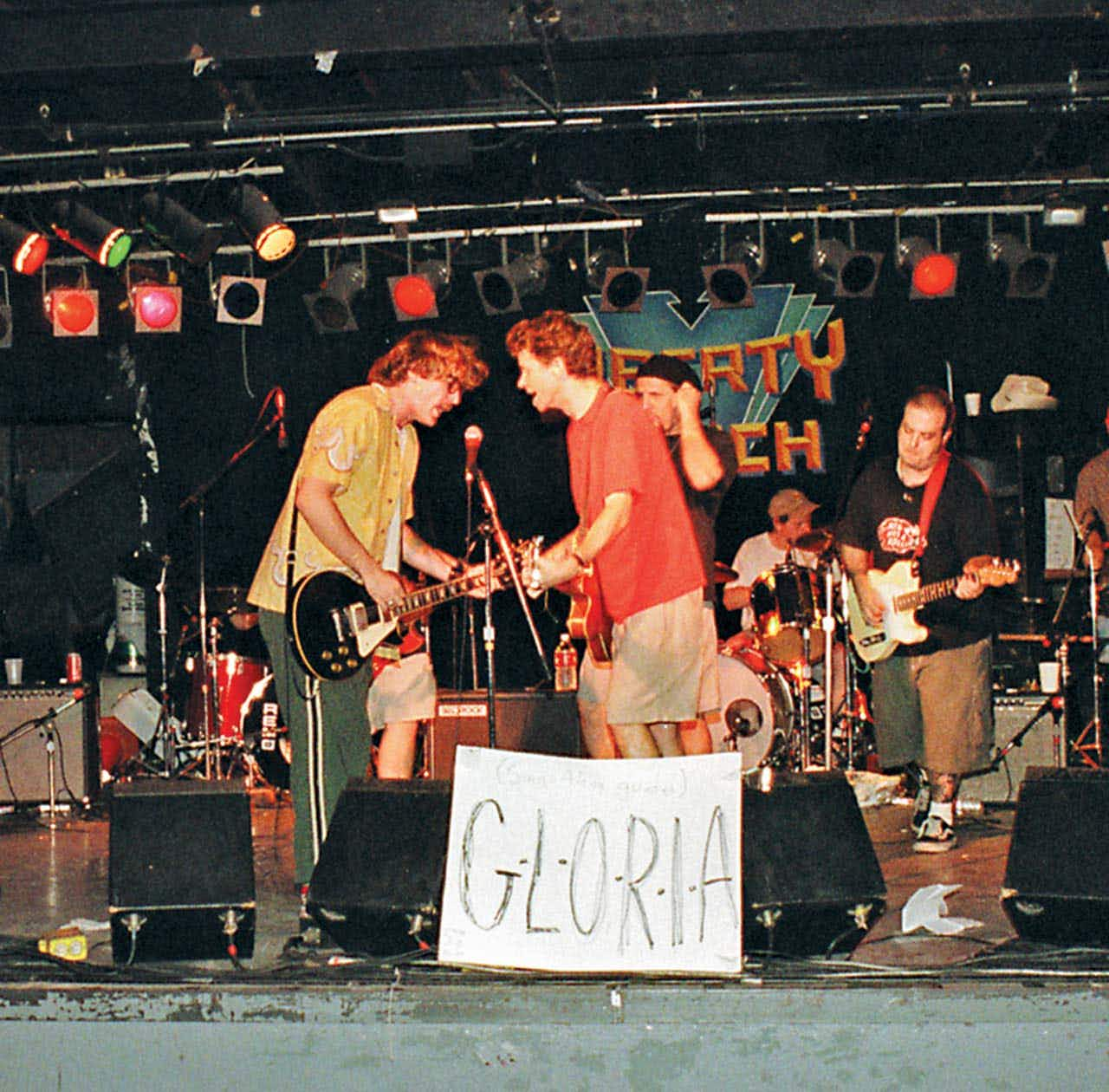 The author (wearing a red shirt) performing at the Gloriathon at Liberty Lunch in 1999.