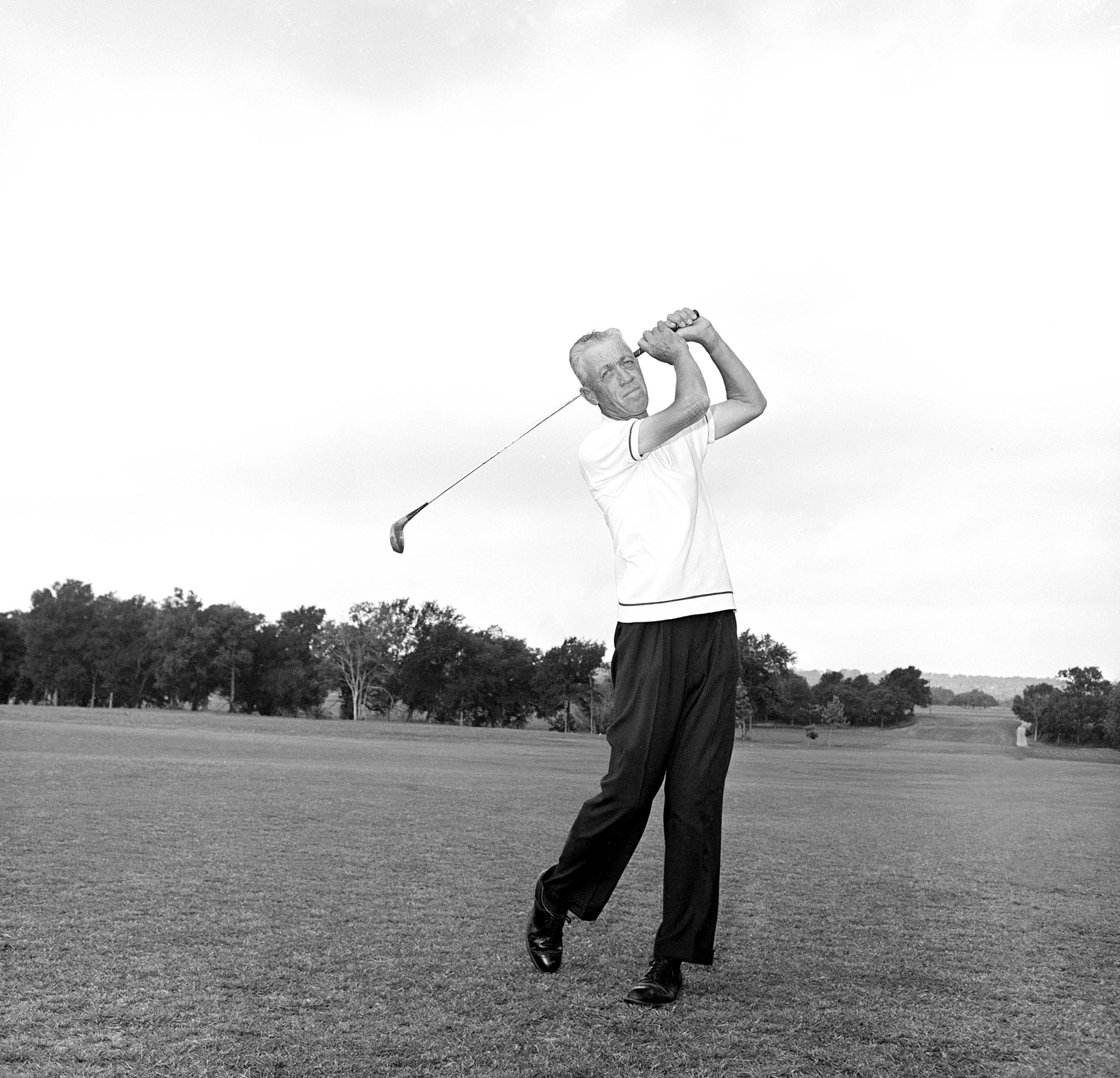 Pro golfer Harvey Penick shown during a posed swing at the Austin, Texas Country Club, May 2, 1964.