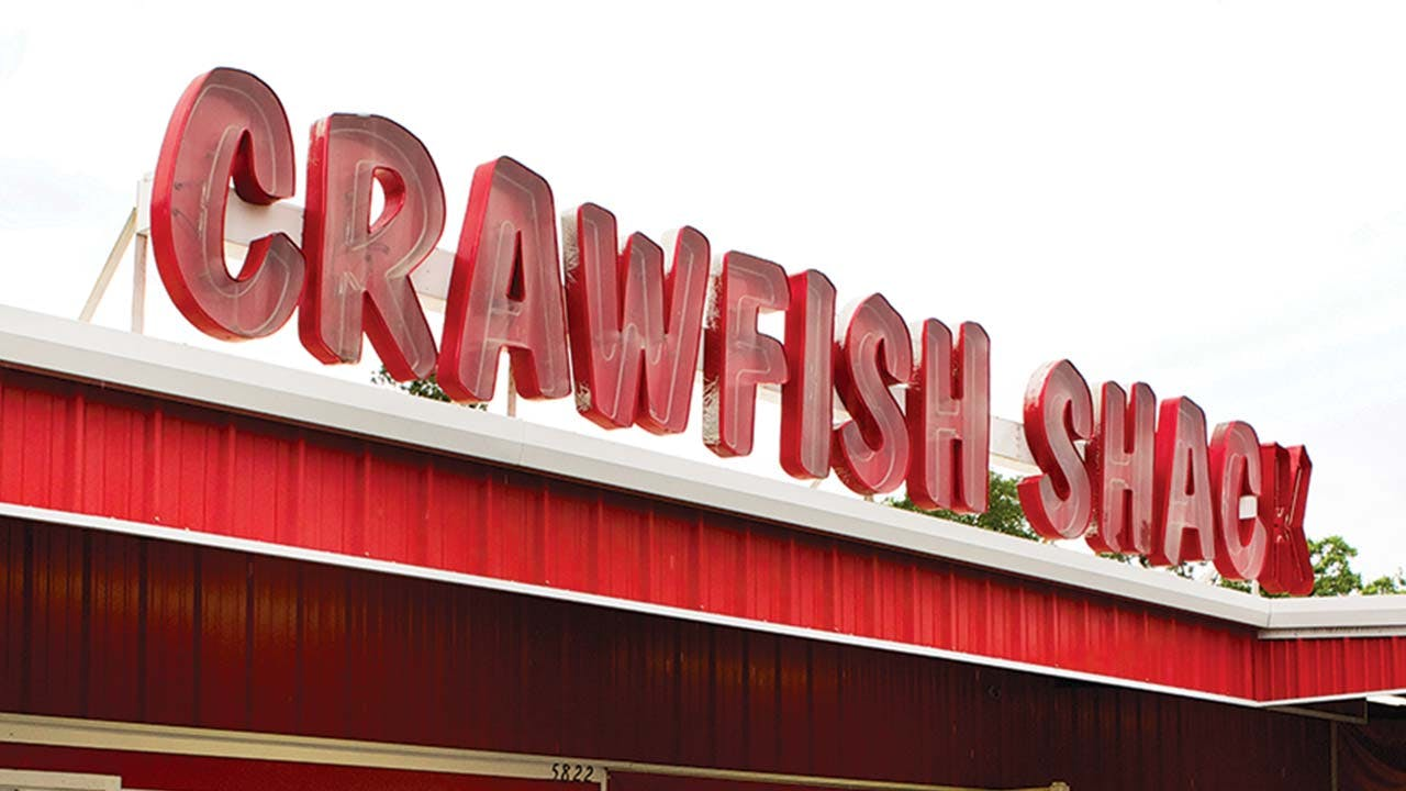feature-crawfish-shack-sign-sky