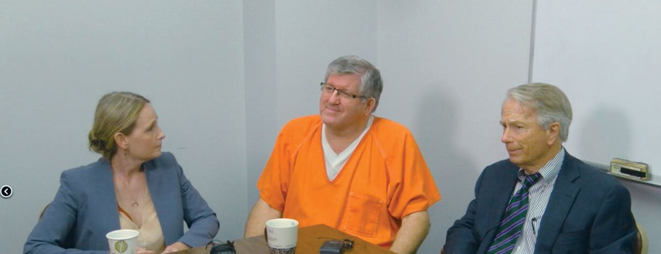 Tiede with his lawyers Jodi Cole and Mike DeGuerin, who vowed to appeal.