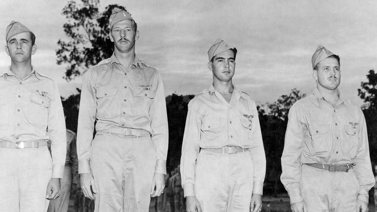 The Air Medal being awarded in 1943 to, from left, First Lieutenant Vivian A. Cloud, Mac, First Lieutenant Francis J. Pitonyak, and First Lieutenant Bacchus B. Byrd Jr.