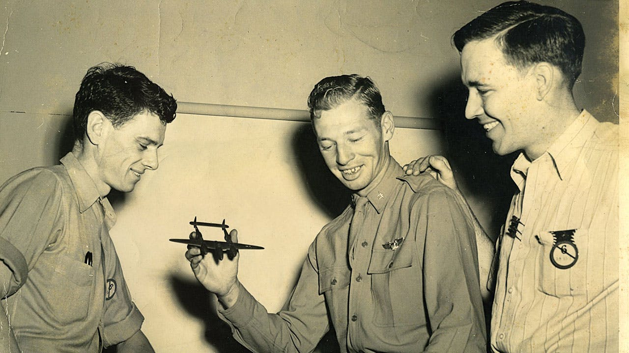 Mac photographed in 1944 describing a maneuver he had performed in his P-38.
