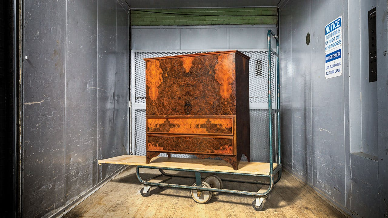 A Blanket Chest ($3,500–$5,000) finished in a walnut-burl veneer.