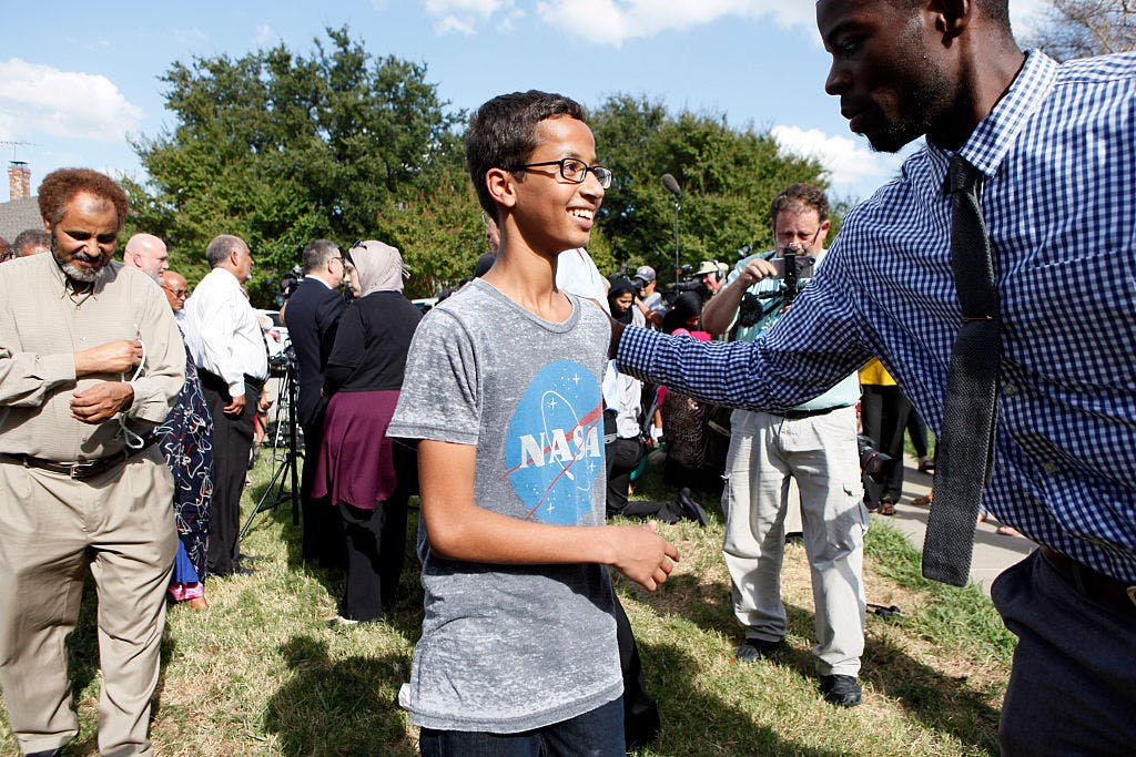4-year-old Ahmed Ahmed Mohamed is greeted by a supporter during a news conference on September 16, 2015 in Irving, Texas. Mohammed was detained after a high school teacher falsely concluded that a homemade clock he brought to class might be a bomb.
