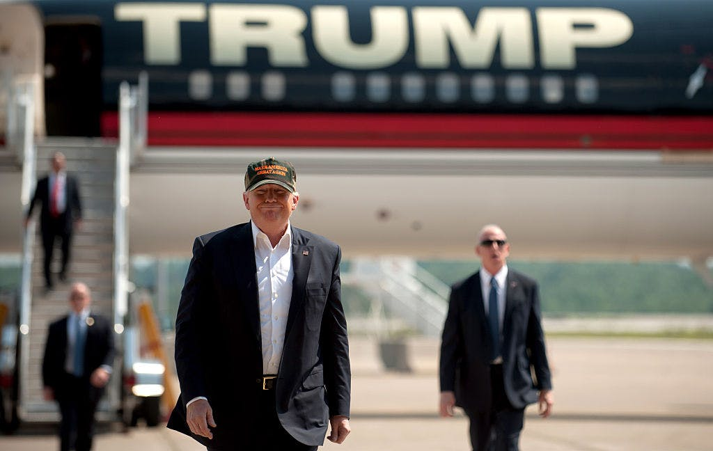 Donald Trump walks from his plane to speak to supporters at a rally at Atlantic Aviation on June 11, 2016 outside Pittsburgh, Pennsylvania.