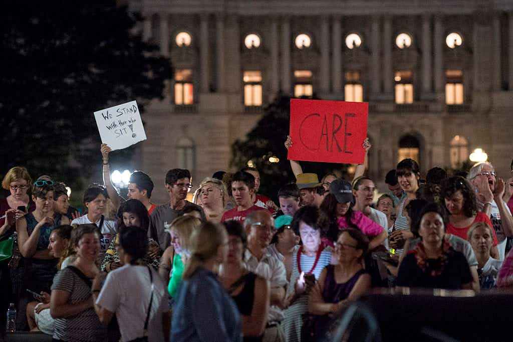 Supporters of House Democrats taking part in a sit-in on the House Chamber shout encouragement from outside the U.S. Capitol on June 22, 2016 in Washington, DC.