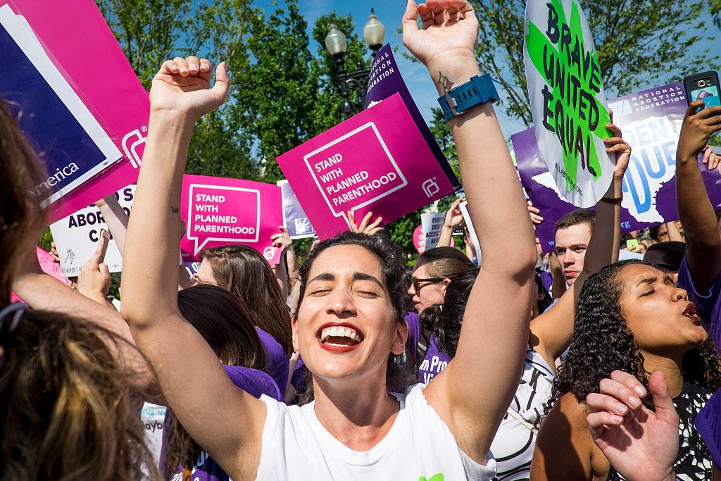 WASHINGTON, DC - JUNE 27: Abortion rights activist Morgan Hopkins of Boston, celebrates on the steps of the United States Supreme Court on June 27, 2016 in Washington, DC. In a 5-3 decision, the U.S. Supreme Court struck down one of the nation's toughest restrictions on abortion, a Texas law that women's groups said would have forced more than three-quarters of the state's clinics to close.