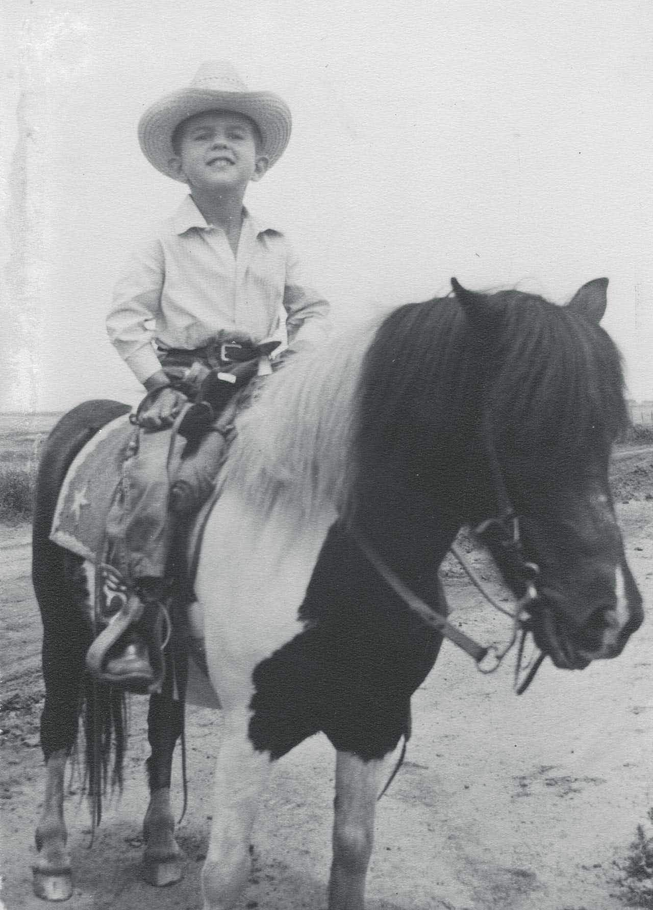 McMurtry as a boy on his family's ranch, sitting on his first pony.