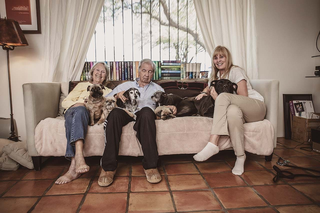 McMurtry with his wife, Faye Kesey (left), and writing partner Ossana, as well as the six dogs with whom they share a home in Tucson.