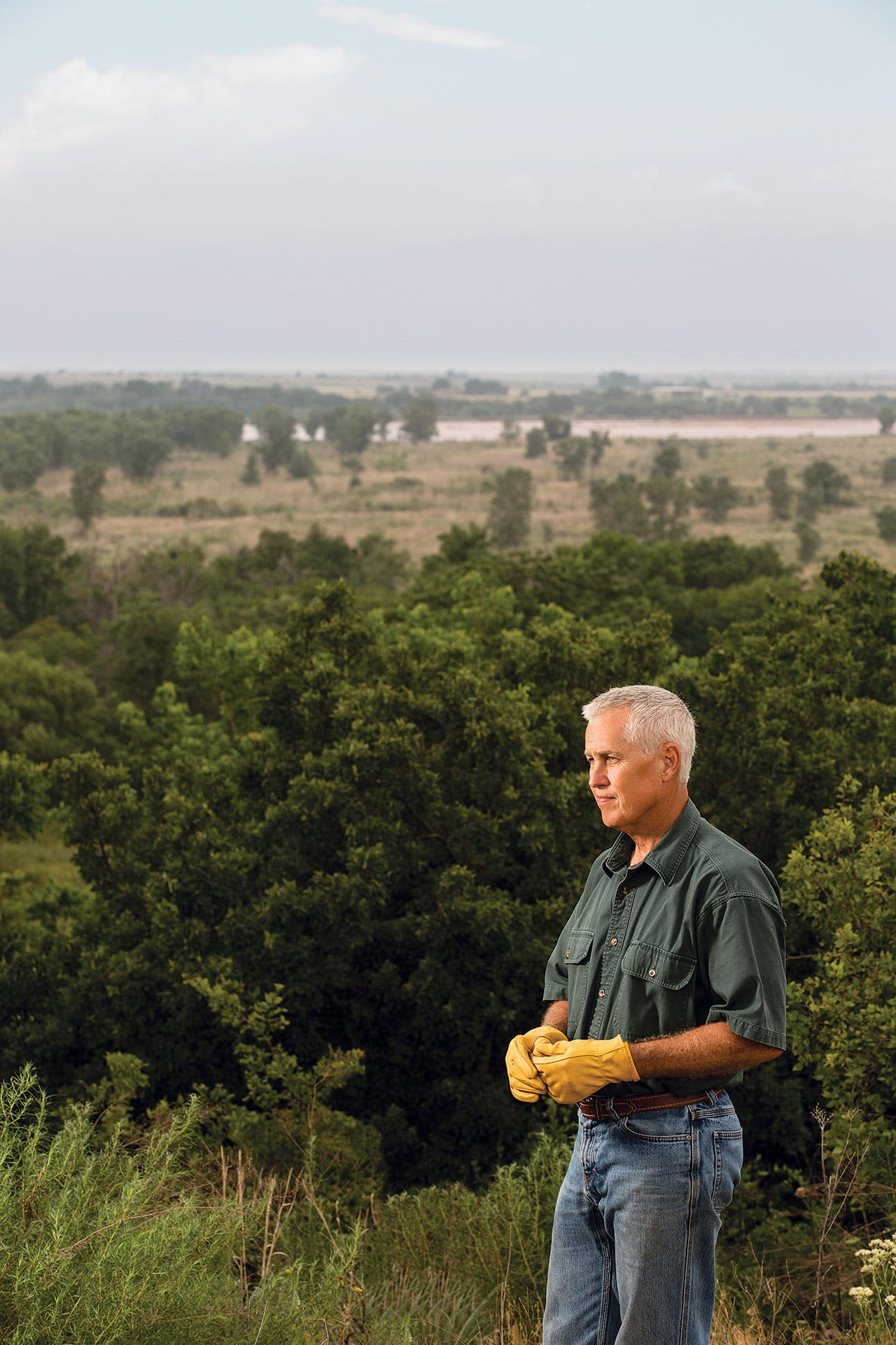 Canan on his North Texas property, with the Red River in the background, on May 26, 2016.