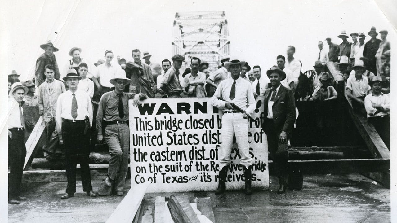 A group of Texans stand guard during the Red River Bridge War on July 20, 1931.