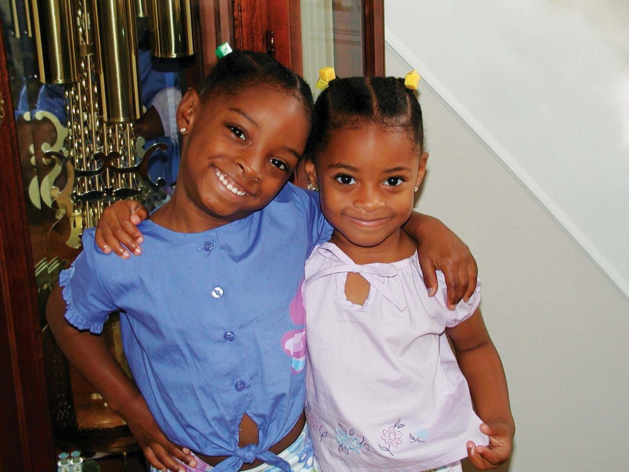 Biles at age six with her younger sister, Adria.