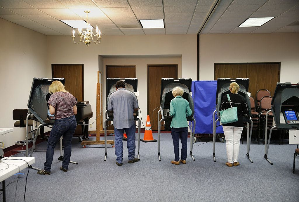 Voters cast their ballots inside Calvary Baptist Church March 1, 2016 March 1, 2016 in Rosenberg, Texas.