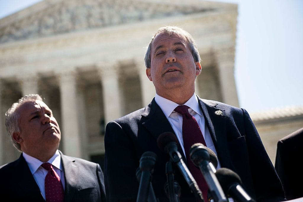 Texas Attorney General Ken Paxton speaks to reporters at a news conference outside the Supreme Court on Capitol Hill on June 9, 2016 in Washington, D.C.