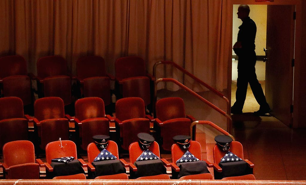 Five reserved seats sat empty, honoring five slain Dallas police officers during an interfaith memorial service at the Morton H. Meyerson Symphony Center on July 12, 2016 in Dallas, Texas.