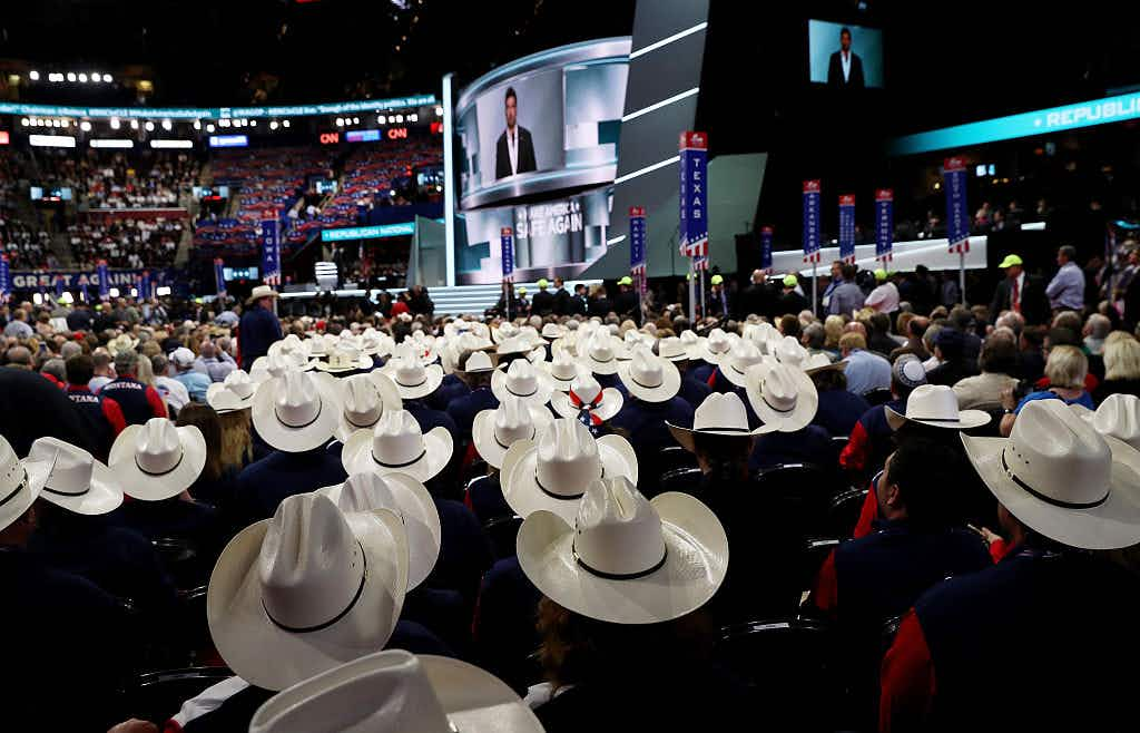 Texas delegates listen to former Navy SEAL Marcus Luttrell deliver a speech on the first day of the Republican National Convention on July 18, 2016 at the Quicken Loans Arena in Cleveland, Ohio.